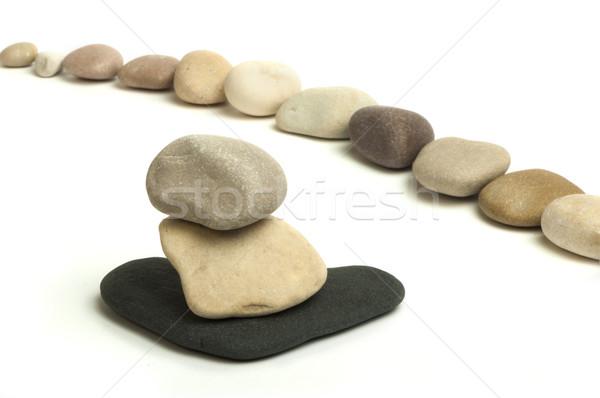 Stacked stones white isolated Stock photo © deyangeorgiev