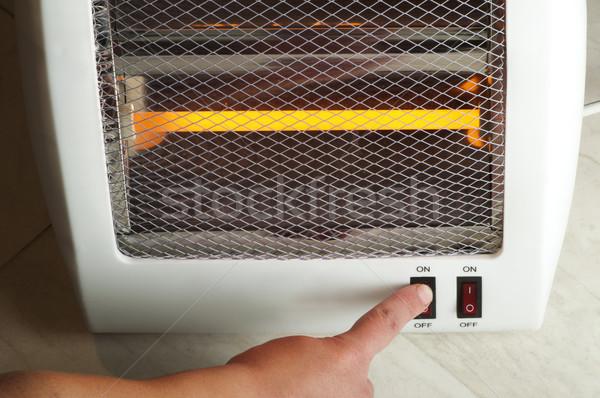 Elétrico aquecedor mão mudar halogênio casa Foto stock © deyangeorgiev