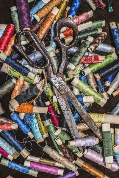 Old vintage scissors on spools of thread Stock photo © deyangeorgiev