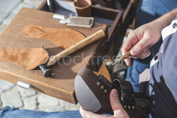 Hands making shoes Stock photo © deyangeorgiev