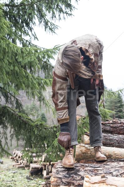 Stock photo: Man tie shoes