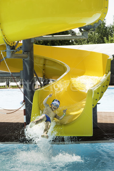 Stock photo: Children slide down a water slide