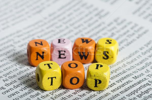 Word top news.Wooden cubes on magazine Stock photo © deyangeorgiev