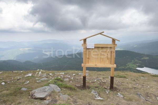 Wooden signboard in the mountain Stock photo © deyangeorgiev