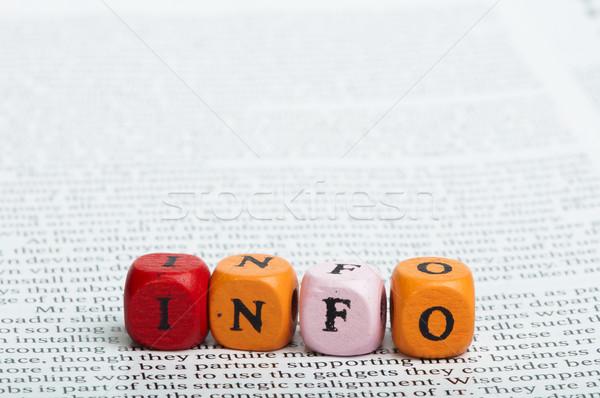 Word info.Wooden cubes on magazine Stock photo © deyangeorgiev