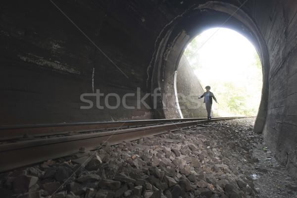 Criança caminhada ferrovia túnel vintage roupa Foto stock © deyangeorgiev