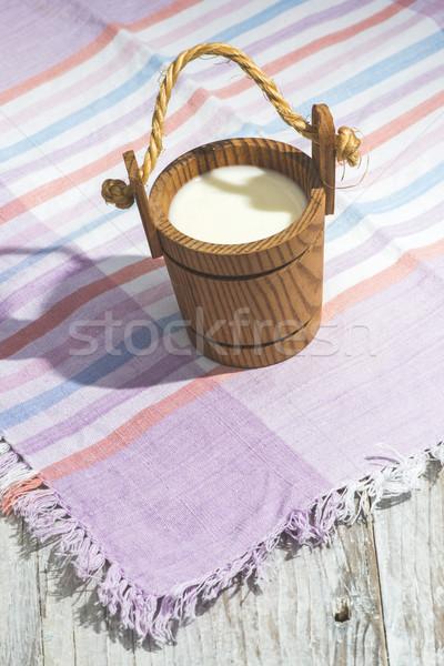 Vintage wooden cup of milk Stock photo © deyangeorgiev