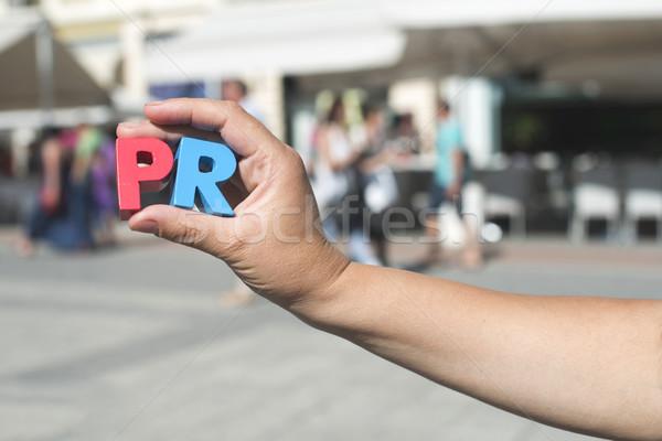 Vrouwen houden houten brieven pr lopen Stockfoto © deyangeorgiev