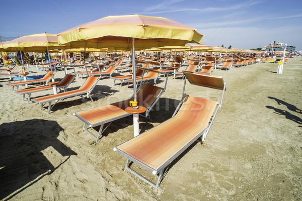 Paraguas playa naranja cielo agua naturaleza Foto stock © deyangeorgiev