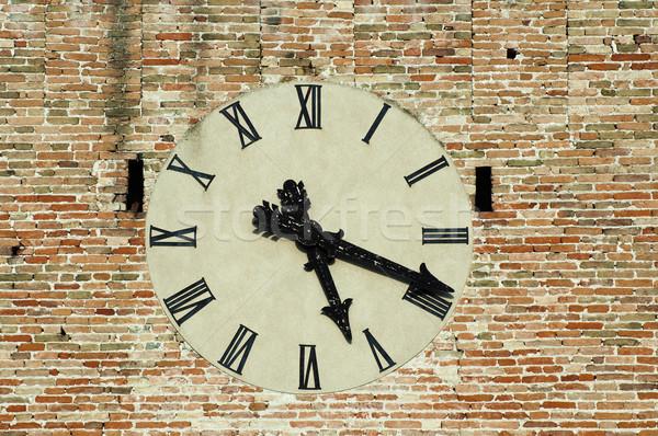 Antique clock on a building. Stock photo © deyangeorgiev