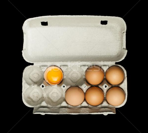Eggs box and aggs inside Stock photo © deyangeorgiev