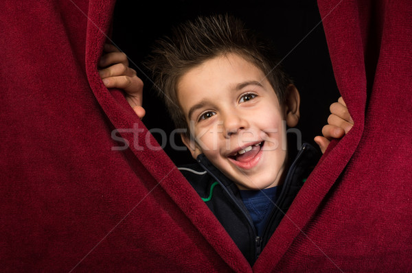 Child appearing beneath the curtain Stock photo © deyangeorgiev