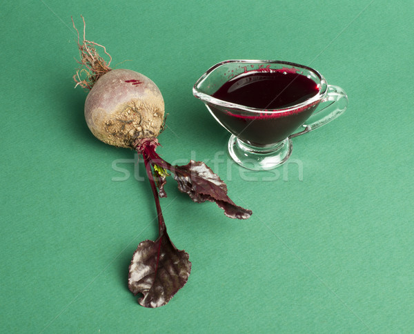 Red beets with leaves and jug with juice Stock photo © deyangeorgiev
