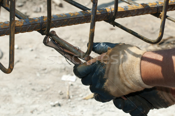 Construction worker ties reinforcing steel Stock photo © deyangeorgiev
