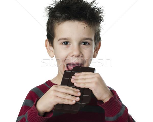 Smiling kid eating chocolate Stock photo © deyangeorgiev
