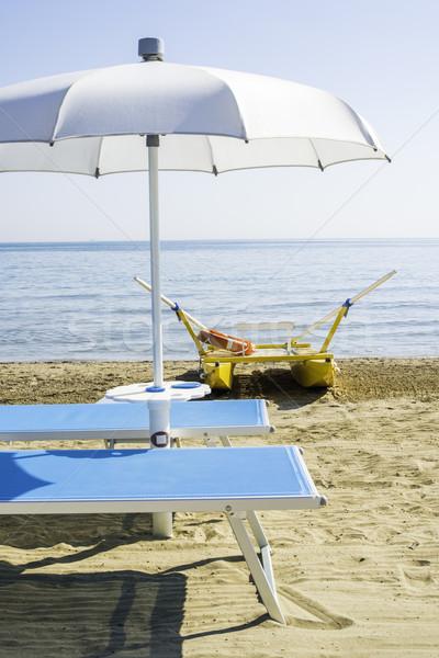 Parapluies plage bleu eau soleil mer Photo stock © deyangeorgiev