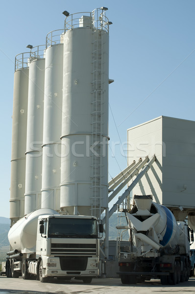 Cement factory and a truck loading cement Stock photo © deyangeorgiev