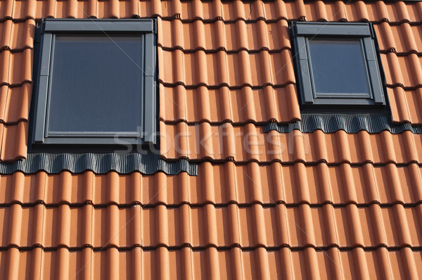 Azulejos telhado vermelho casa janela arquitetura Foto stock © deyangeorgiev