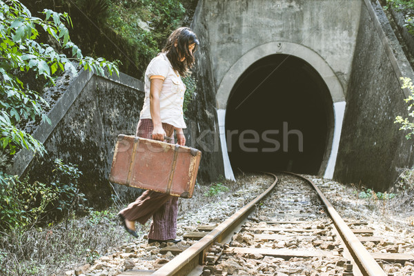 Woman walk on railroad with a suitcase in hands Stock photo © deyangeorgiev