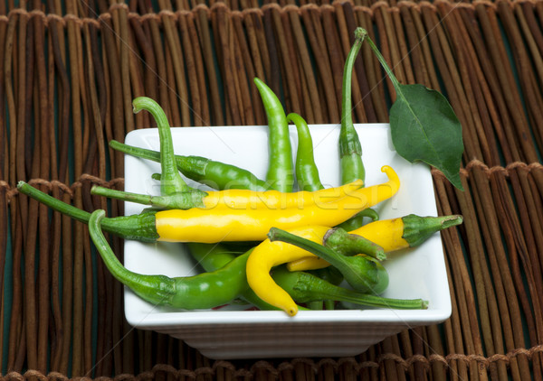 Stock photo: Small thin green chili peppers