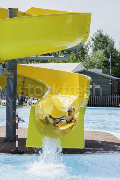 Kinderen slide beneden waterglijbaan water Stockfoto © deyangeorgiev
