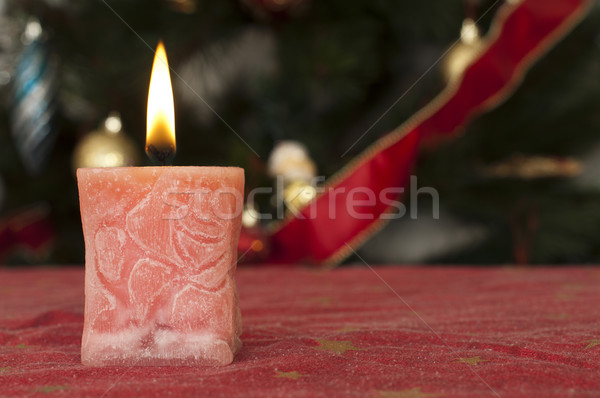 Christmas candle on the festive table Stock photo © deyangeorgiev