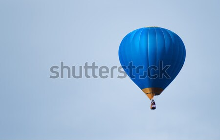 Blue balloon in the blue sky Stock photo © deyangeorgiev