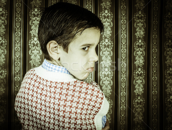 Frowning child vintage clothes. Stock photo © deyangeorgiev