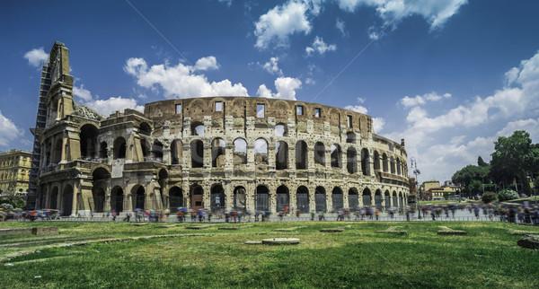 Colosseum Rome groen gras gras Blauw reizen Stockfoto © deyangeorgiev