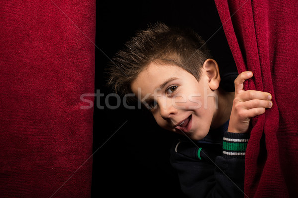 Child appearing beneath the curtain Stock photo © deyangeorgiev