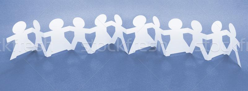 Együttlét csetepaté papír lánc babák kéz a kézben Stock fotó © dezign56