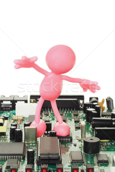 Rubber figurine playing on electronic circuit board  Stock photo © dezign56