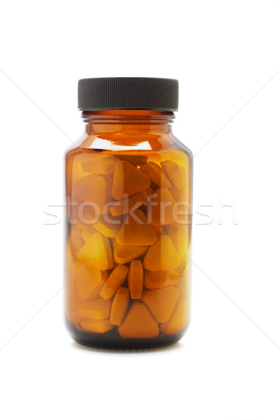 Medicine bottle with tablets Stock photo © dezign56