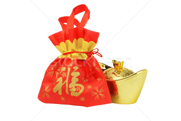 Chinese New Year Gift Bag and Gold ingot Ornament Stock photo © dezign56