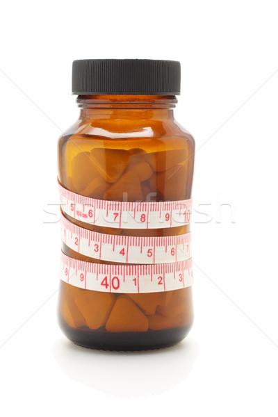 Centymetrem diety pigułki szkła butelki biały Zdjęcia stock © dezign56