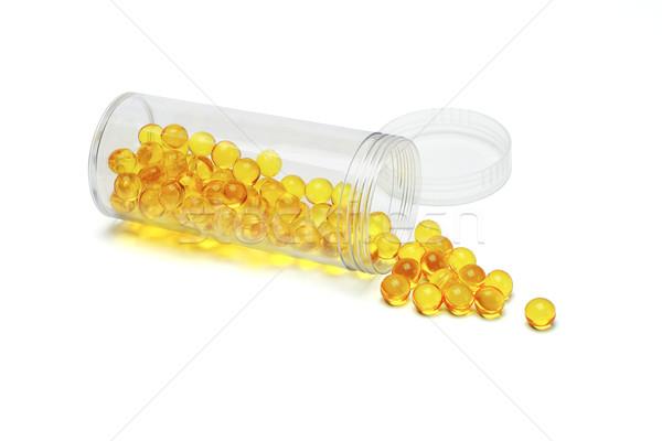 желтый таблетки медицина открытых контейнера белый Сток-фото © dezign56