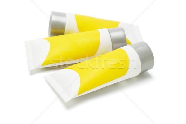 Três amarelo plástico branco Foto stock © dezign56