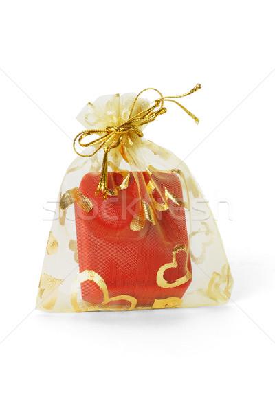 Red jewellery box in gold sachet  Stock photo © dezign56