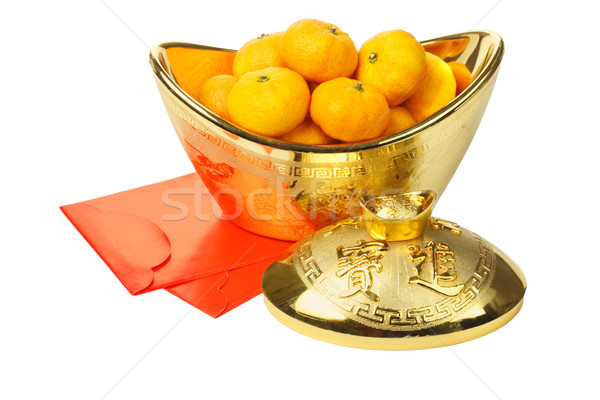 Mandarin Oranges in Gold Ingot and Red Packets Stock photo © dezign56