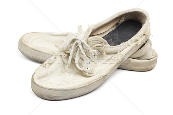 Alten getragen Leinwand Schuhe Paar weiß Stock foto © dezign56