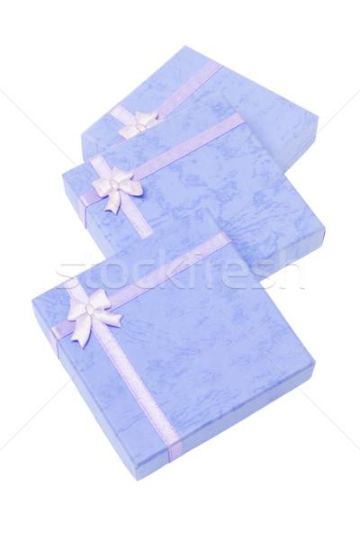 üç hediye kutuları mavi beyaz kâğıt hediye Stok fotoğraf © dezign56