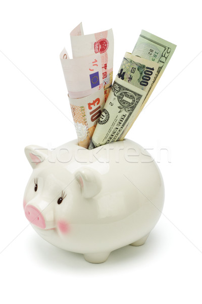 Piggy bank and major world currency notes Stock photo © dezign56