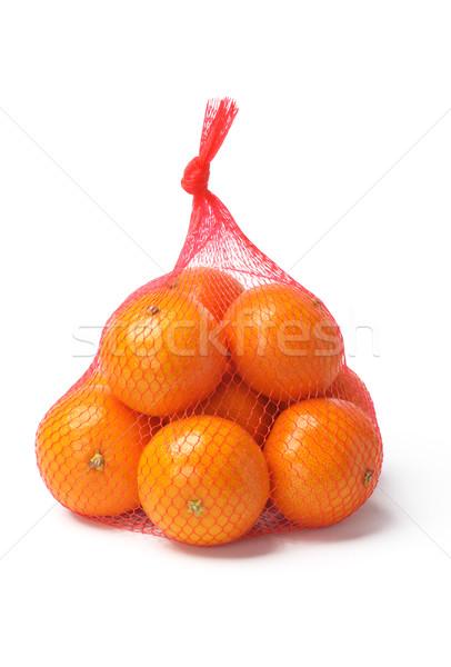 Oranges in Plastic Mesh Sack  Stock photo © dezign56