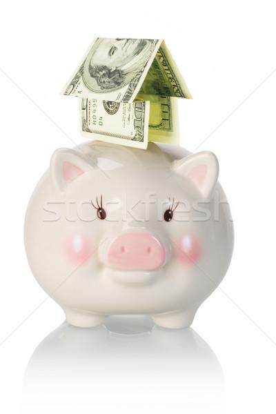 Investimento priorità soldi casa piggyback salvadanaio Foto d'archivio © dezign56