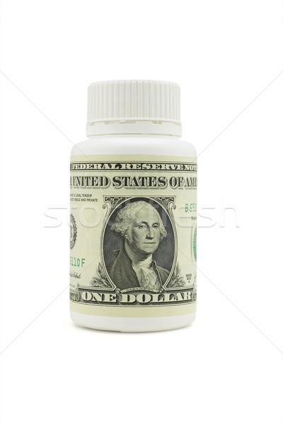 US dollar on white plastic medicine bottle Stock photo © dezign56