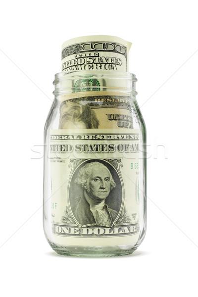 Dólar notas vidro jarra abrir branco Foto stock © dezign56