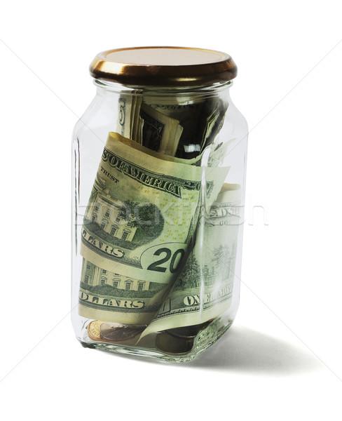 долларов монетами стекла банку деньги Сток-фото © dezign56
