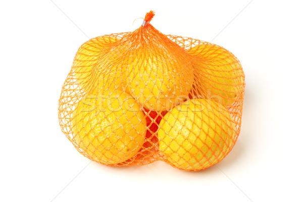 Fresh lemons in plastic sack Stock photo © dezign56