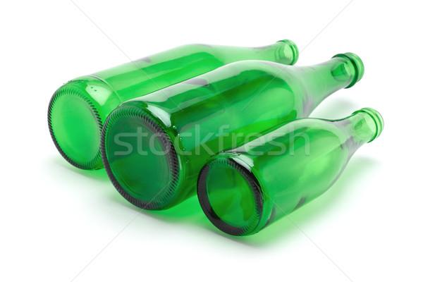 üç yeşil şişeler cam beyaz bira Stok fotoğraf © dezign56