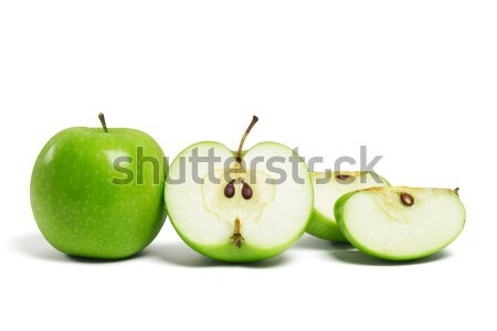 Whole green apple and cut pieces Stock photo © dezign56